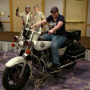 Shannon astride one of the motorcycles from the 70s TV cop drama CHiPs
