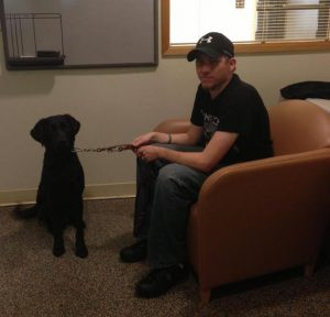 Ed Worrell and his black lab guide dog, Halie.