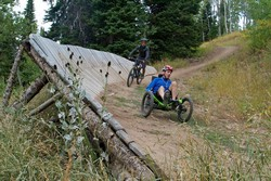 Peter Drakos races on a track through the woods on his adapted bike.