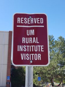 "Sign designating MonTECH's parking spot, says ""Reserved UM Rural Institute Visitor"""