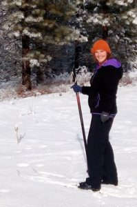 Theresa hiking in the snow.