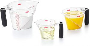 Clear, plastic pitcher-style measuring cups.
