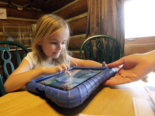 Piper Heinz remotely navicates her robot around the kindergarten classroom in Victor