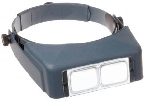 An early wearable magnifier called an Optivisor.