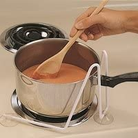 Pot is stabilized on stove top so it can be stirred one-handed without sliding around.