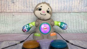 Light-up sloth toy with two switches attached