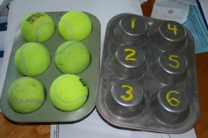 tennis balls and muffin tin