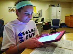 Olivia Hawley with iPad